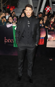 Kellan Lutz opted for a darker red carpet style than his vampire cohorts in a black Dolce & Gabbana suit. Showing off some new facial hair, the 'Breaking Dawn' star turned heads in the three-piece suit.