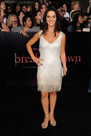 Andrea Gabriel channeled a '20s flapper in a shining silver fringed dress at the 'Breaking Dawn' premiere. The brunette opted for low-heeled metallic strappy sandals and coordinating silver accessories.