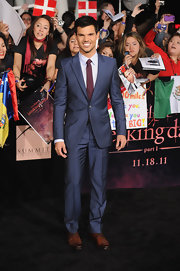 A smiley Taylor Lautner hit the Breaking Dawn red carpet in a navy Alexander McQueen suit. A burgundy tie and cognac dress shoes added pop to his style.
