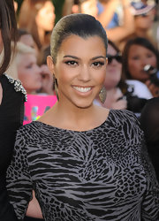 Kourtney opted for a sleek ponytail on the red carpet, which she paired with killer dangling earrings.