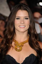 Danica Patrick flaunted her enviable bone structure with a fabulous gold statement necklace.