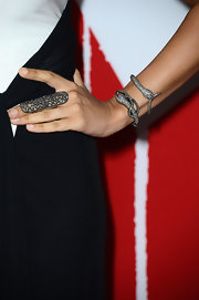 Tia Mowry doubled up on diamond snake bangles.