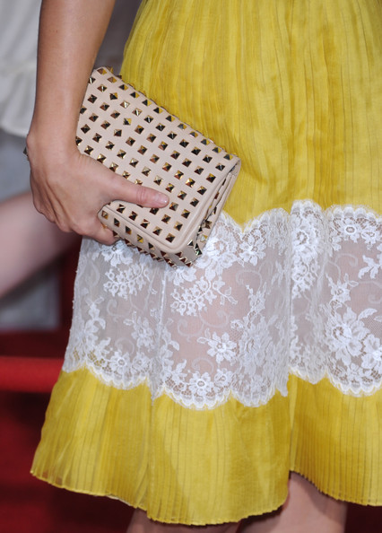 Kristen Bell paired her Valentino dress with a nude studded clutch.
