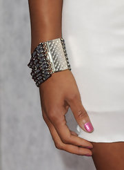 Disney star Monique Coleman showed off this metal cuff bracelet which did a great job highlighting her white one-shouldered dress.