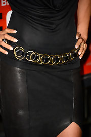 Halle Berry added some metal to her red carpet look with a gold chain leather belt.