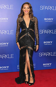 Carmen Ejogo finished off her fierce cutout, glittery, high-slit, low-neck gown with a pair of always-elegant peep-toes.