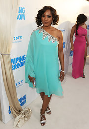 Angela Bassett matched the crystals of her asymmetrical aqua dress with strappy silver sandals.
