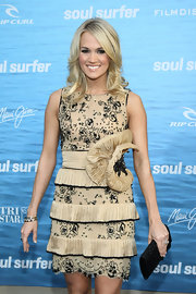 Carried donned a nude cocktail dress with layers of pleats and an exuberant floral detail at the waist for the 'Soul Surfer' premiere.