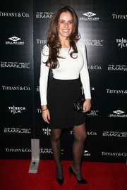 Gabriela Dias paired her top with a black mini skirt for a subtly sexy finish.