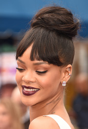 Rihanna swept her hair up into a retro-chic top knot for the premiere of 'Home.'