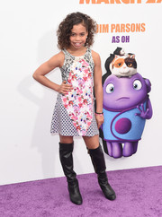 Asia Monet Ray attended the premiere of 'Home' wearing a cute mix of prints.