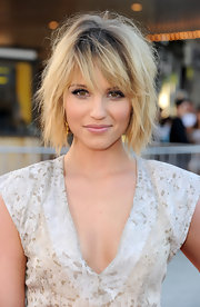 At the premiere of 'Glee' 3D concert movie, star Dianna Agron showed a new sexy side in a tousled layered bob with dark roots and razor-cut side-swept bangs.