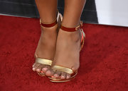 Tiya Sircar chose a metallic gold sandal for her simple and chic red carpet look.