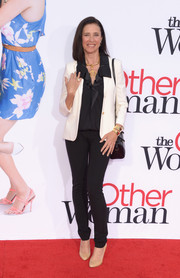 Mimi Rogers finished off her outfit with a pair of black skinny pants.
