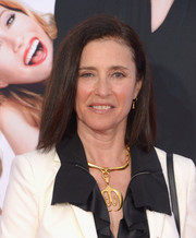Mimi Rogers glammed up her look with a huge gold pendant when she attended the LA premiere of 'The Other Woman.'
