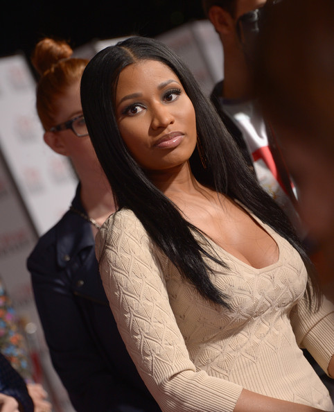It was refreshing to see Nicki Minaj minus all the frills at the LA premiere of 'The Other Woman,' where she sported this minimalist-chic center-parted straight hairstyle.