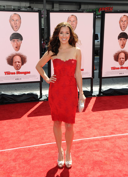 """Carly Craig stepped onto the red carpet at the 'Three Stooges' premiere wearing a pair of """"knot me"""" cream satin peep-toe pumps."""