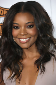 Gabrielle Union attended the premiere of 'Good Deeds' with sexy smoky eyes done in shimmering neutral shadows.
