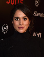 Meghan Markle looked lovely wearing this mildly messy updo at the 'Suits' season 5 premiere.