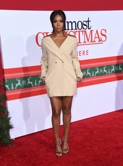 Gabrielle Union looked cool and modern in a nude off-the-shoulder blazer dress by Dion Lee at the premiere of 'Almost Christmas.'