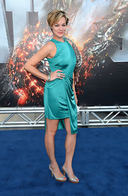 Crystal Allen arrived at the LA premiere of 'Battleship' wearing silvery gray slingbacks.