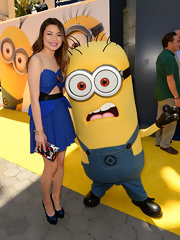Miranda Cosgrove matched a multicolored print clutch with her cobalt dress when she attended the premiere of 'Despicable Me 2.'