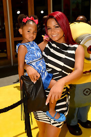 Christina Milian paired a tasseled black leather clutch with her sexy dress when she attended the 'Despicable Me 2' premiere.