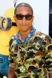 Pharrell Williams showed off his interesting style while hitting the red carpet at the 'Despicable Me' premiere.