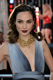 Gal opted for a big and bold dark chocolate lip color to complement her deep brown locks.