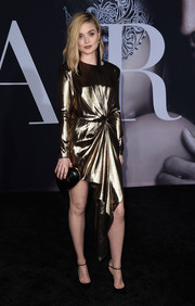 Bella Heathcote was a chic standout in her draped gold Saint Laurent dress at the premiere of 'Fifty Shades Darker.'