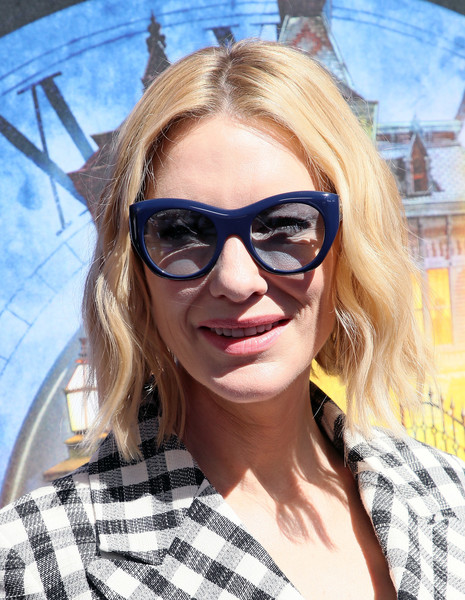 Cate Blanchett kept the sun out with a pair of blue cateye shades.