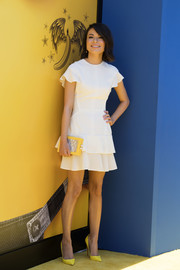 Miranda Cosgrove styled her dress with a pair of yellow Christian Louboutin pumps.