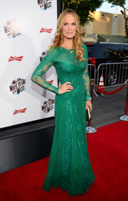 Molly Sims looked queenly in a long-sleeve green lace gown during the premiere of 'A Million Ways to Die in the West.'