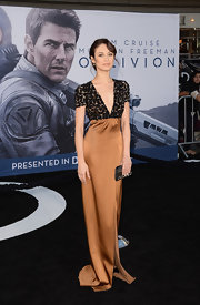 Olga Kurylenko simply stunned in this caramel gown, featuring a beaded bodice with a deep V-neck.