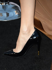 Olga Kurylenko kept her shoes fairly basic but chic with this pair of patent leather pumps.