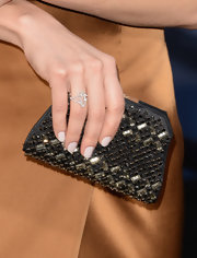 Although we're not sure she could hold much in there, we just love Olga Kurylenko's beaded clutch.
