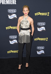 Elizabeth Banks looked totally captivating in a fringed silver halter top by Marchesa during the premiere of 'Pitch Perfect 2.'