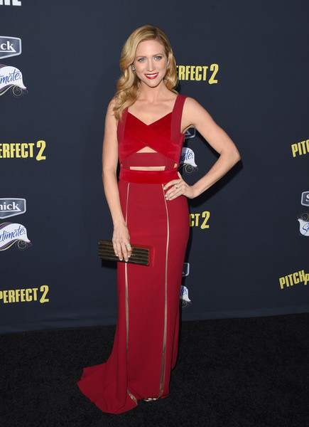 Brittany Snow styled her dress with a chic gold box clutch by Lee Savage.