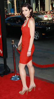 Mary went glam in a fitted halter dress with metallic slingback sandals.
