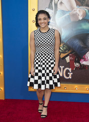Laurie Hernandez worked a striking mix of prints in this Ted Baker London dress at the premiere of 'Sing.'