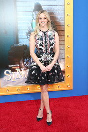 Reese Witherspoon paired her cute frock with black satin ankle-strap pumps by Christian Louboutin.