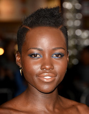 Lupita Nyong'o made her eyes pop with a heavy dose of bright blue shadow.