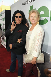 Shannon Tweed carried an oversize metallic clutch at premiere of 'Ted.'