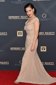 Dita Von Teese brought a dose of vintage glamour to the 'Jeremy Scott: The People's Designer' premiere with this flowing, micro-beaded nude gown.