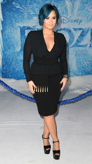 Demi Lovato teamed her LBD with a pair of ultra-high black platform sandals.