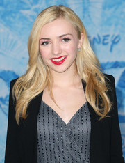 Peyton List injected a shock of color to her neutral ensemble with bright red lipstick.