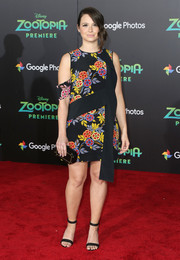 Katie Lowes styled her dress with a black and gold hard-case clutch by Edie Parker.