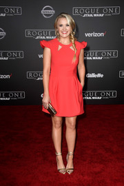 Emily Osment chose elegant gold ankle-wrap sandals to finish off her look.