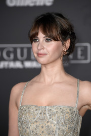 Felicity Jones styled her hair into a romantic chignon with parted bangs for the premiere of 'Rogue One: A Star Wars Story.'