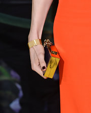 Rachel Weisz carried a classic gold clutch while at the 'Oz' premiere in LA.